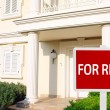 Real estate sign in front of new house for rent — Stock Photo #83212660