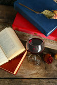 Beautiful composition with glass of wine with old books on table close up — Stock Photo