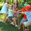Happy active children playing in park — Stock Photo #83925190
