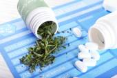 Bottles of dry medical cannabis and pills on table close up — Stock Photo