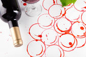 Spots made with wine cork and bottle of wine isolated on white — Stock Photo