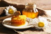 Honey products on wooden table — Stock Photo