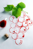 Grapes made with wine cork and goblet of spilled wine — Stock Photo