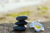Spa stones with flowers outdoors — Stock Photo