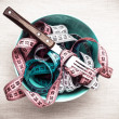 Many measuring tapes in bowl on table — Stock Photo #72484635