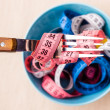 Many colorful measuring tapes in bowl on table — Stock Photo #73519131