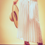 Summer fashionable shoes on female legs. — Stock Photo #79415266