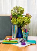 Teacher  Day. Hydrangea flowers and copybooks on the teacher's desk — Stock Photo