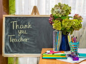 Teacher  Day. Hydrangea flowers and copybooks on the teacher's desk — Stock Photo