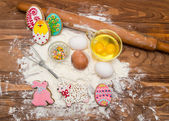 Easter cookies and ingredients for cooking. — Stock Photo