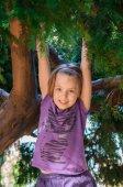 Girl on the tree. — Stock Photo