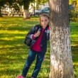 Pretty girl of school age in the autumn park. — Stock Photo #56167735