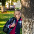 Pretty girl of school age in the autumn park. — Stock Photo #56167757