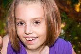 Little girl looks with big eyes — Stok fotoğraf