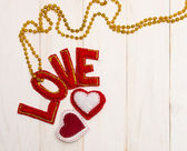 Red letters love and textile hearts. — Stock Photo