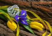 Flower iris and tulips with water drops on wooden background — Stock fotografie