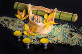 Spa concept. Orchid flowers, sea salt, candles and objects for s — Stock Photo