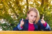 Outdoor portrait of a pretty girl school age — Stock Photo