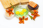 Orange lily flowers, boxes, sea salt, candles, soap  and objects — Stock Photo