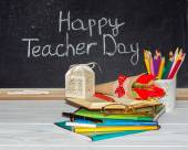 Teacher  Day. Flowers and gift; copybooks on the teacher's desk. — Stock Photo