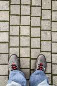 Feet of a man on the pavement — Stock Photo