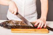 Chef kitchen knife cut the fish  — Photo