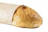Long loaf in paper packing — Stock Photo