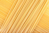 Pasta lying diagonally — Stock Photo
