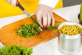 Chef finely shred dill and parsley  — Stok fotoğraf