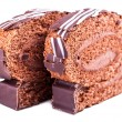 Two slices of chocolate Swiss roll closeup — Stock Photo #62666719