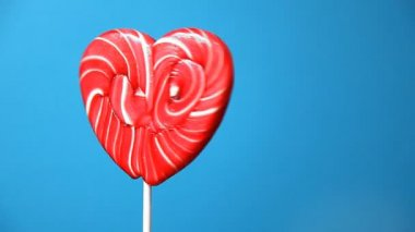 Lollipop in the form of an heart — Stock Video