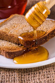 Toast drenched with honey close-up  — Stock Photo