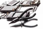 Dismantle the phone and pliers  — Stock Photo