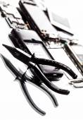 Dismantle the phone and pliers closeup  — Stock Photo