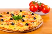 Hot fresh a pizza with tomatoes  — Stockfoto