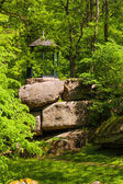 Arbor on large rocky boulders — Stock Photo