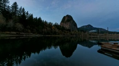 Time Lapse Movie of Beacon Rock State Park along Columbia River Gorge in Washington State at Sunset into Blue Hour with Water Reflection and Moving Clouds 1080p — Stock Video