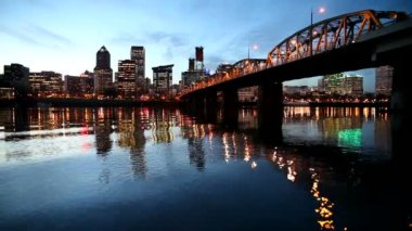 Downtown City Skyline of Portland Oregon along Willamette River with Hawthorne Bridge and Blue Hour Water Reflection Ripples at Night 1080p — Stock Video