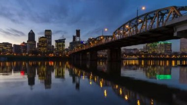 Panning Time Lapse Movie of Portland Oregon Downtown Cityscape with Hawthorne Bridge and Water Reflection from Blue Hour into Night Scene 1080p — Stock Video