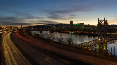 Time Lapse Movie of Freeway Traffic along Willamette River with Portland Downtown Cityscape and Water Reflection at Sunset 1080p — Stock Video