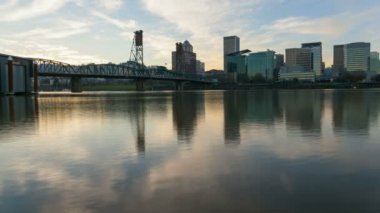 Time Lapse of Moving Clouds along Willamette River with Downtown Cityscape Hawthorne Bridge and Water Reflection from Sunset into Evening in Portland Oregon 1080p — Stock Video
