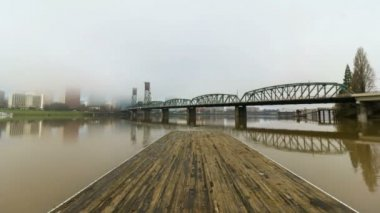 Time Lapse Movie of Moving Low Clouds and Fog Over Downtown City Skyline of Portland Oregon with Hawthorne Bridge and Water Reflection along Willamette River One Early Misty Winter Morning 1920x1080 — Stock Video