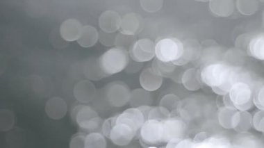 Out of Focus Silver Bokeh Circle Dots of Glistening Water Background Movie 1080p — Stock Video