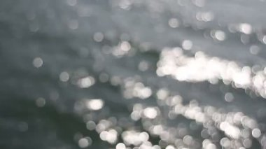 Out of Focus Silvery Bokeh Circle Dots of Glistening Water Background into Focus Clear Water Movie 1080p — Stock Video