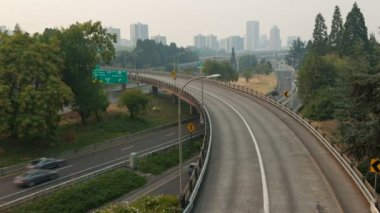 Ultra High Definition 4k Time Lapse Movie of Freeway Traffic with Downtown City Skyline of Portland Oregon on a Hazy Day from Forest Fires 4096x2304 — Stock Video