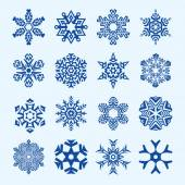 Sixteen vector snowflakes isolated on blue — Stockvektor