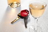 Ignition key and hard liquer — Stock Photo