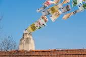Euro money flies up the chimney — Stock Photo