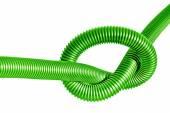 Node on the green  plastic tube — Stock Photo