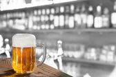 Glass of beer in the pub — Stock Photo